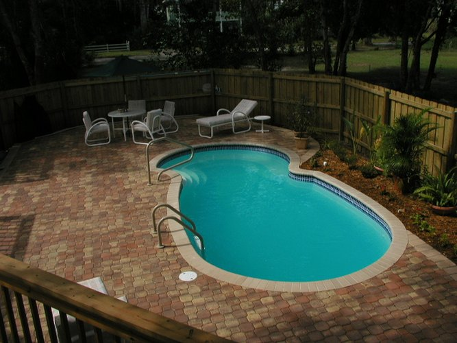 Benefits of fiberglass pools best pool builder champaign for Pool building companies