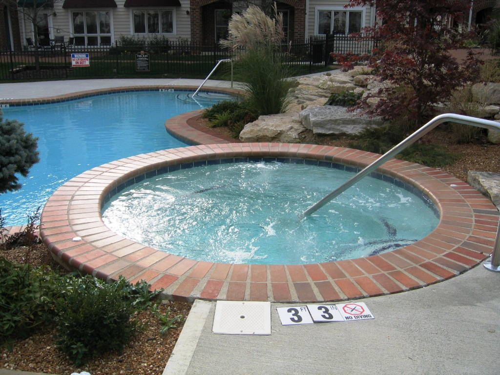 Soak away your stress in a hot tub for Pool design with hot tub